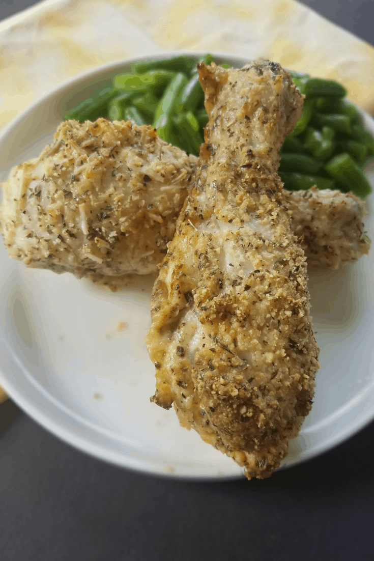 This Festivo Parmesean Chicken Legs recipe features yummy chicken legs, drenched in egg and dipped in Italian seasoning with Parmesean cheese crust. www.easyketodishes.com