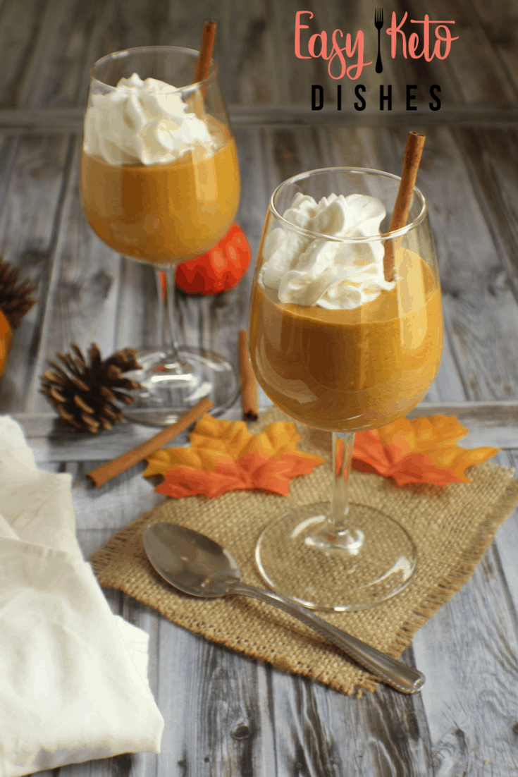 pumpkin cream mousse in wine glass with cinnamon stick and whipped cream
