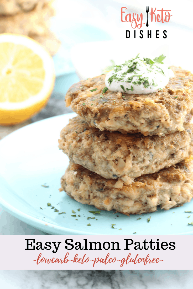 salmon patties on blue plate with lemon
