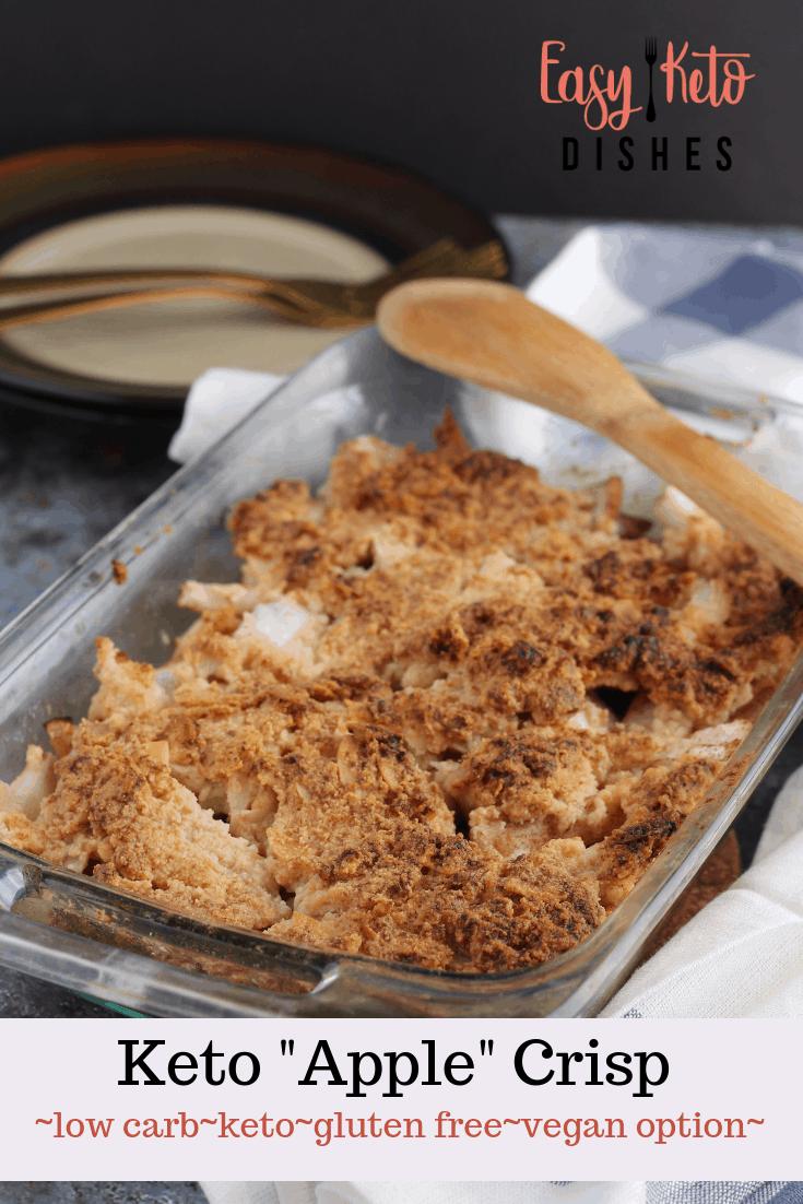 keto apple crisp in 11x7 pan with wooden spoon