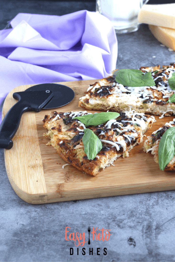 chicken spinach alfredo pizza on cutting board