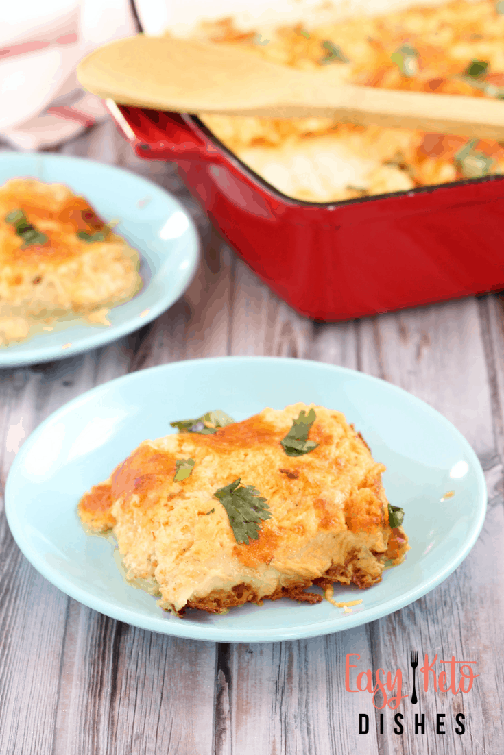 slice of hashbrown casserole on blue plate with casserole dish in back