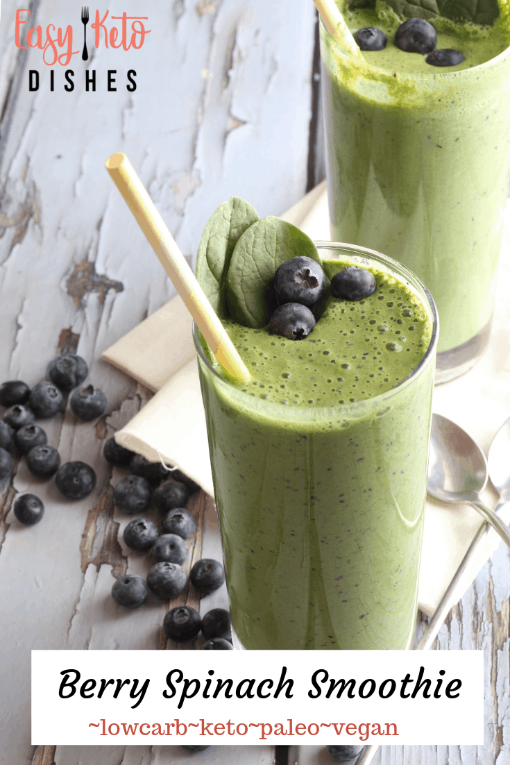 berry spinach smoothies in glasses with yellow straws