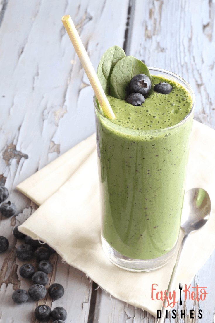 berry spinach smoothie with straw