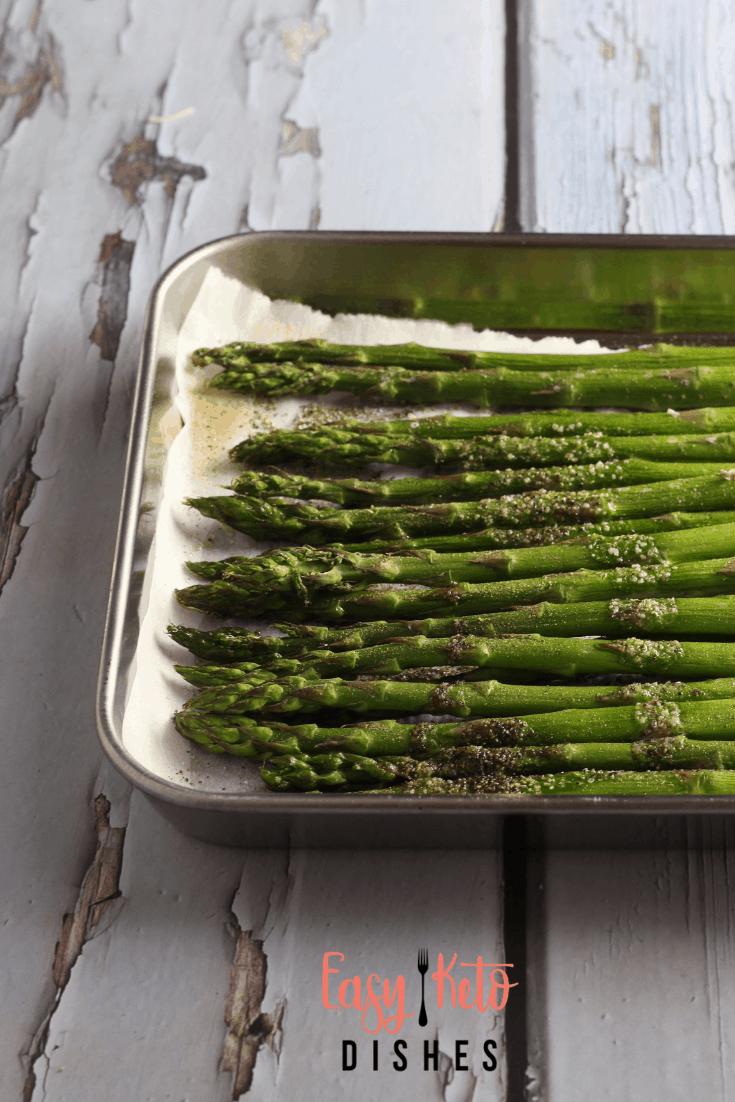 broiled asparagus on baking sheet