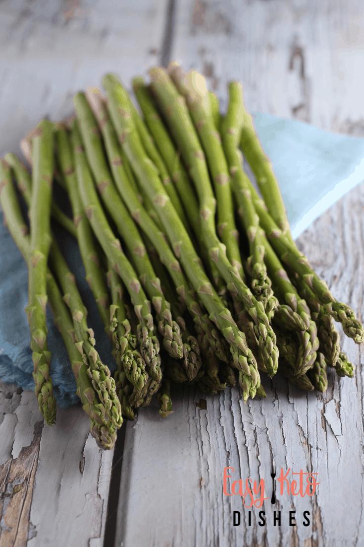 raw asparagus on blue napkin