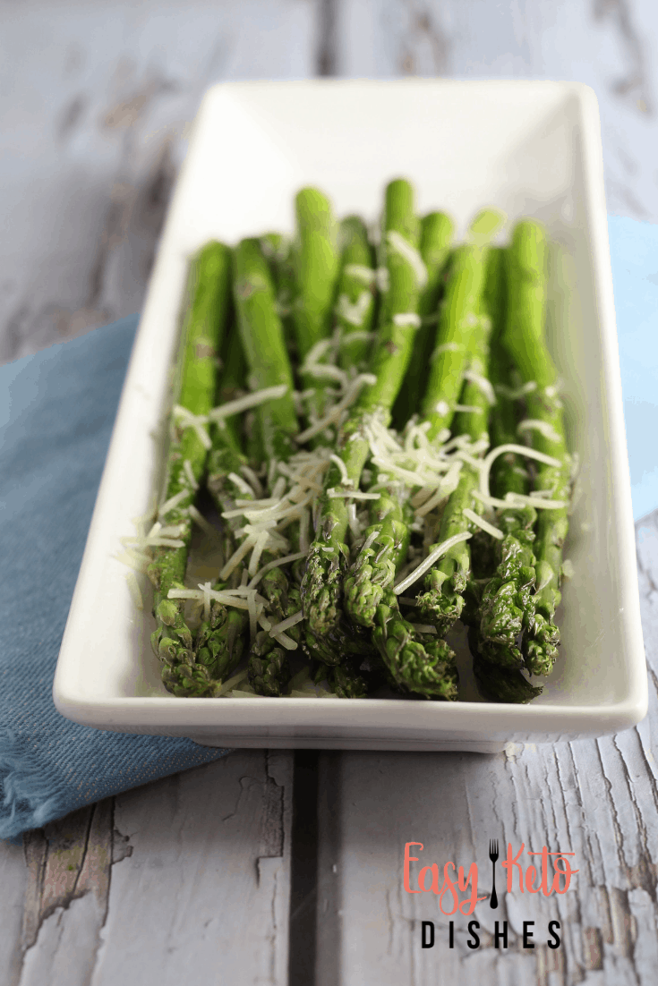 broiled asparagus on plate with parmesan cheese