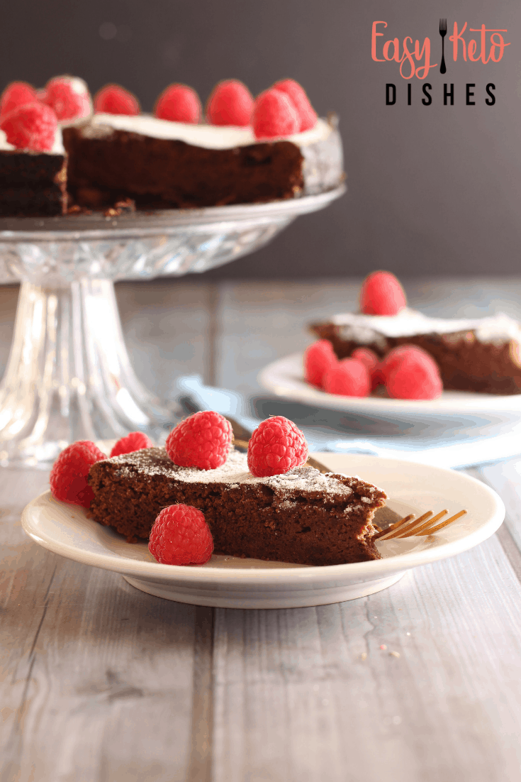 slice of chocolate cake on plate in front of cake stand