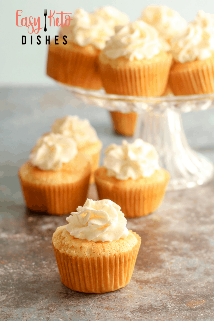 keto vanilla cupcakes on cake stand
