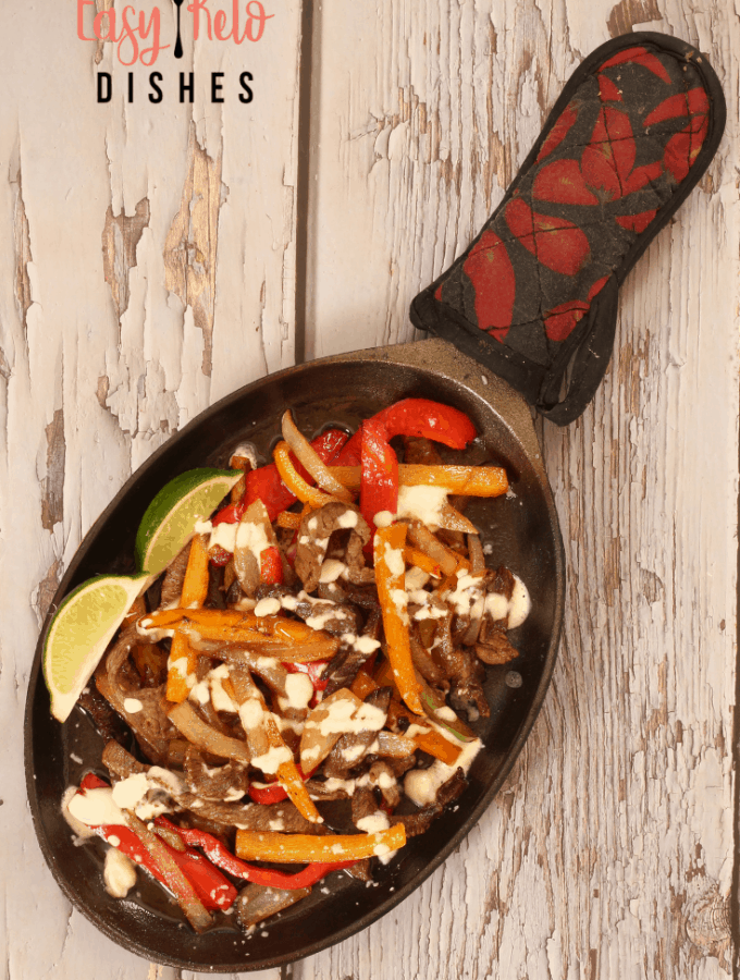 steak fajitas on cast iron pan