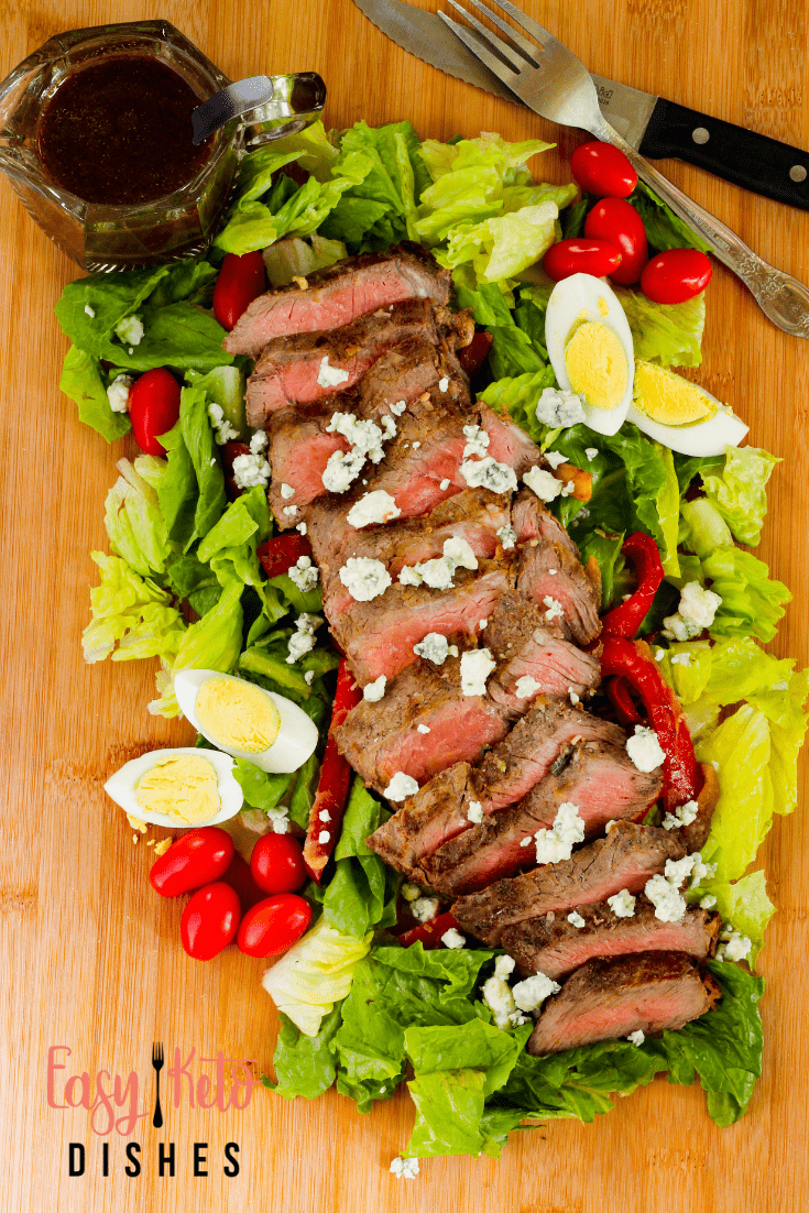 ribeye flatiron steak salad on cutting board