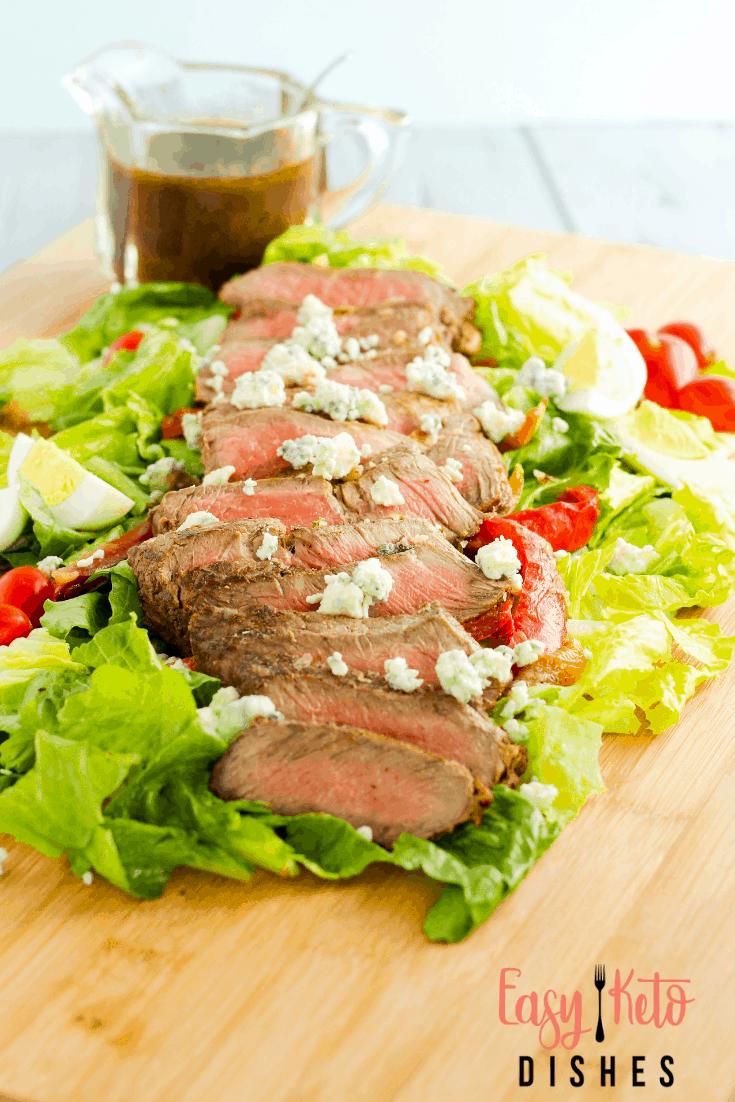 streak salad on cutting board
