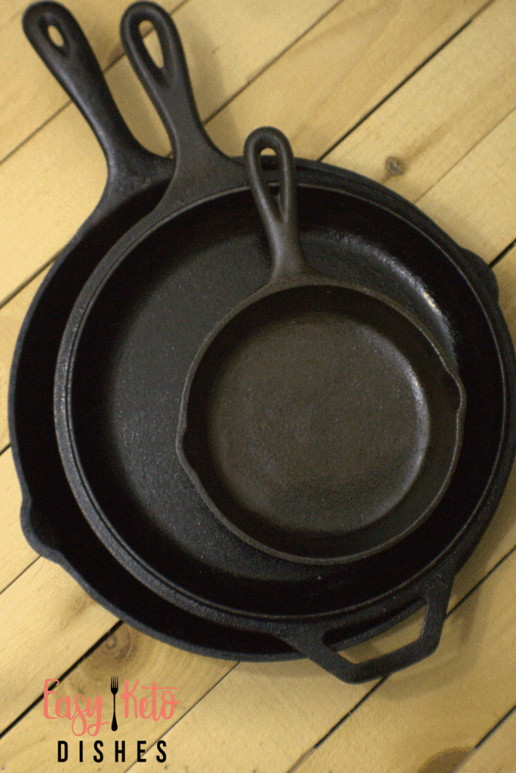 cast iron pans stacked on top of each other